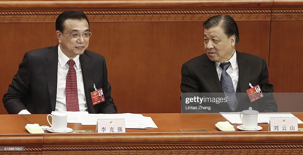 Chinese Premier <a gi-track='captionPersonalityLinkClicked' href=/galleries/search?phrase=Li+Keqiang&family=editorial&specificpeople=2481781 ng-click='$event.stopPropagation()'>Li Keqiang</a> (L) talk with <a gi-track='captionPersonalityLinkClicked' href=/galleries/search?phrase=Liu+Yunshan&family=editorial&specificpeople=5623429 ng-click='$event.stopPropagation()'>Liu Yunshan</a> (R) member of the Standing Committee of the Political Bureau of the Communist Party of China during the closing session of the National People's Congress in the Great Hall of the People on March 16, 2016 in Beijing, China.