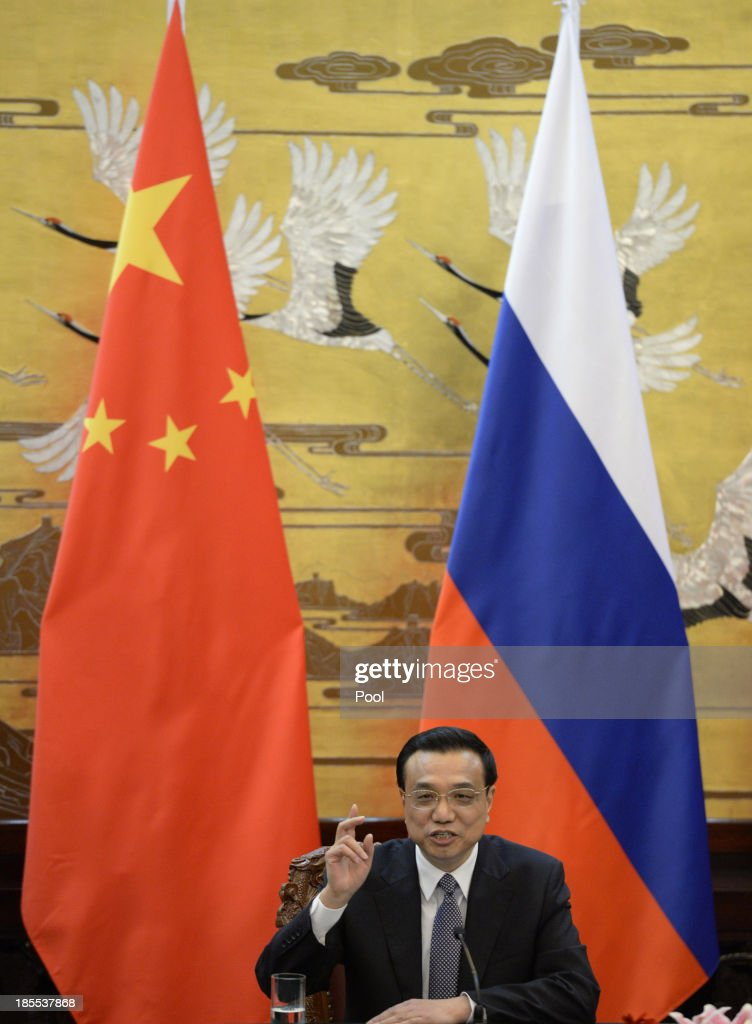 Chinese Premier Li Keqiang talks during a signing ceremony with Russian Prime Minister Dmitry Medvedev (not pictured) at the Great Hall of the People on October 22, 2013 in Beijing, China. Medvedev is in China on a two-day visit as a guest of Chinese Premier Li Keqiang to co-chair the 18th regular meeting between the Chinese and Russian heads of government.