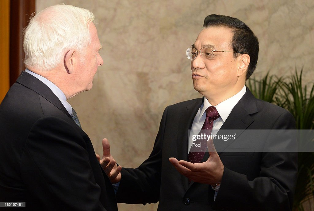 Chinese Premier <a gi-track='captionPersonalityLinkClicked' href=/galleries/search?phrase=Li+Keqiang&family=editorial&specificpeople=2481781 ng-click='$event.stopPropagation()'>Li Keqiang</a> (R) talks to Canadian Governor General David Johnston (L) before a meeting at the Great Hall of the People on October 18, 2013 in Beijing, China. David Johnston is visiting China focusing on Canada-Sino relations and is expected to speak at the Canada China Business Council's annual meeting.
