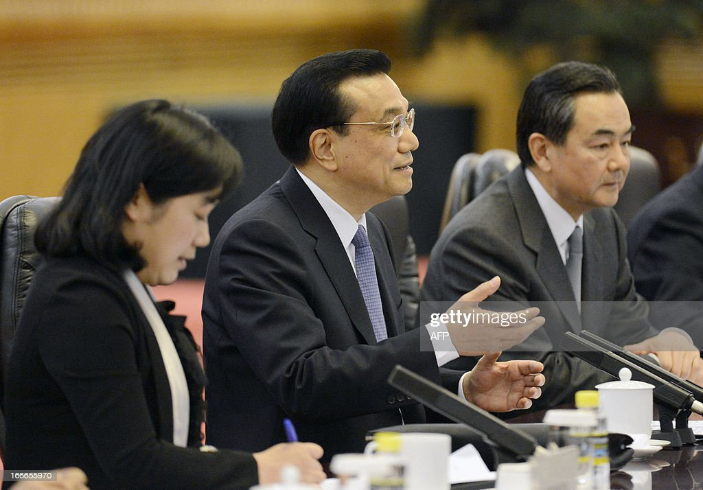 Chinese Premier Li Keqiang (C) talks with Iceland's prime minister Johanna Sigurdardottir (not pictured) during a meeting at the Great Hall of the People in Beijing on April 15, 2013. Sigurdardottir will also meet with former premier Wen Jiabao and President Xi Jinping, on a visit that will include the signing of a trade deal between Reykjavik and Beijing after six years of negotiations.