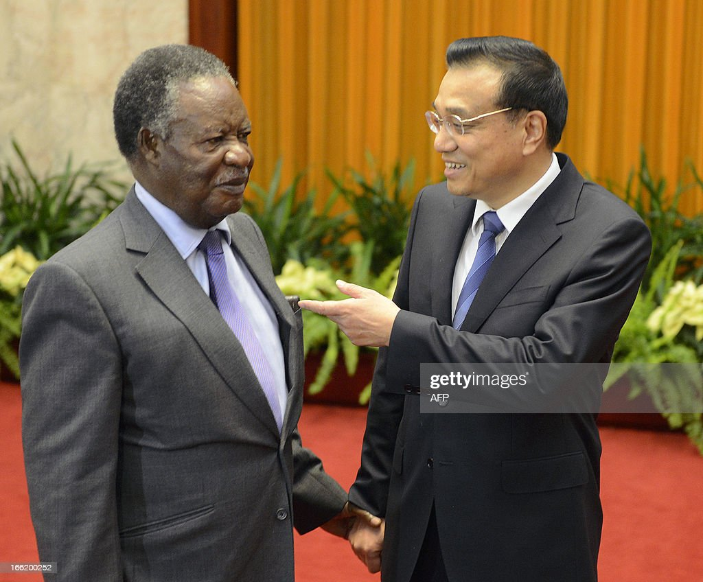 Chinese Premier Li Keqiang (L) talks with Zambia's President <a gi-track='captionPersonalityLinkClicked' href=/galleries/search?phrase=Michael+Sata&family=editorial&specificpeople=1944545 ng-click='$event.stopPropagation()'>Michael Sata</a> (R) before their meeting at the Great Hall of the People in Beijing on April 10, 2013. President Sata is on a seven day visit to China.
