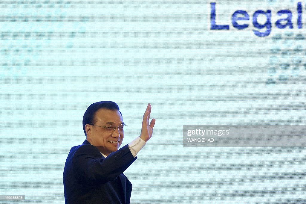Chinese Premier <a gi-track='captionPersonalityLinkClicked' href=/galleries/search?phrase=Li+Keqiang&family=editorial&specificpeople=2481781 ng-click='$event.stopPropagation()'>Li Keqiang</a> waves during the opening ceremony of the 54th annual session of the Asian-African Legal Consultative Organization (AALCO) in Beijing on April 13, 2015. The event is being held in the Chinese capital from April 13 to 17. AFP PHOTO / WANG ZHAO