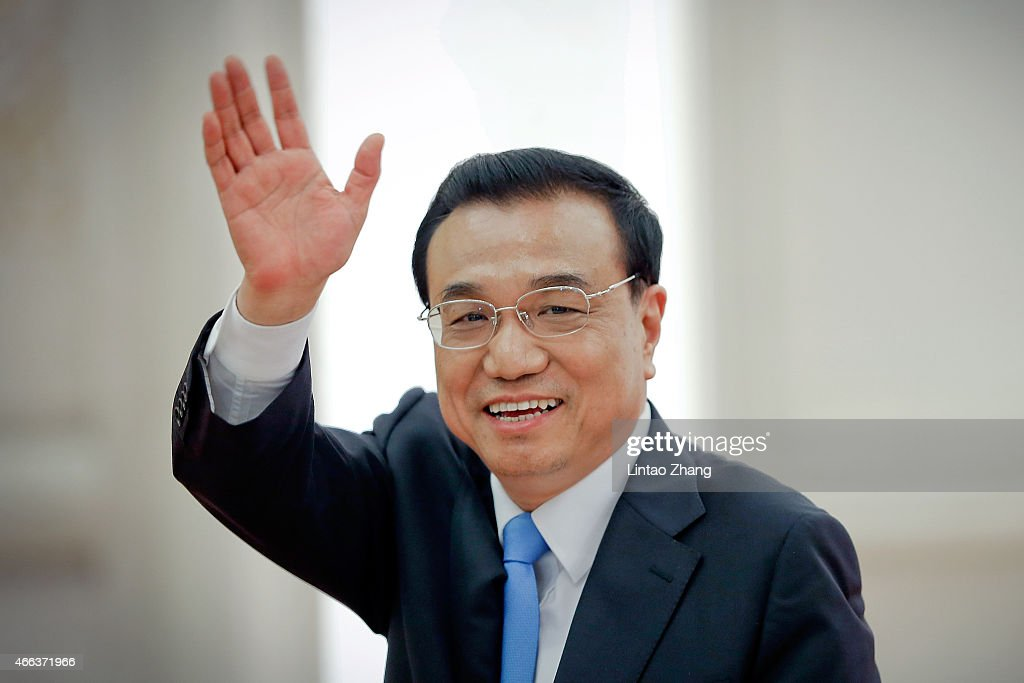 Chinese Premier Li Keqiang waves to journalists as he leaves after a press conference after the closing session of the 12th National People's Congress (NPC) at the Great Hall of the People on March 15, 2015 in Beijing, China.