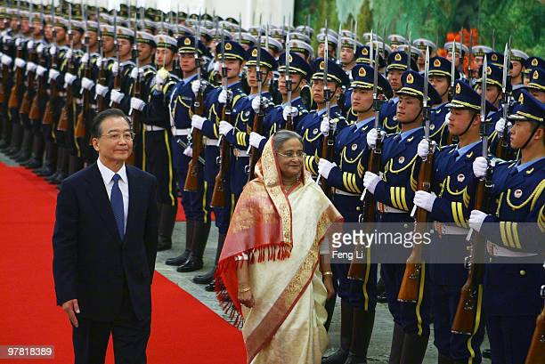 Chinese Premier Wen Jiabao accompanies Premier of the People's Republic of Bangladesh Ms Sheikh Hasina to view an honour guard during a welcoming...