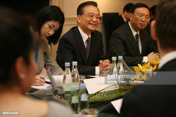 Chinese Premier Wen Jiabao and as his Foreign Minister Yang Jiechi attend a meeting with young business people at the Mandarin Oriental Hotel in...
