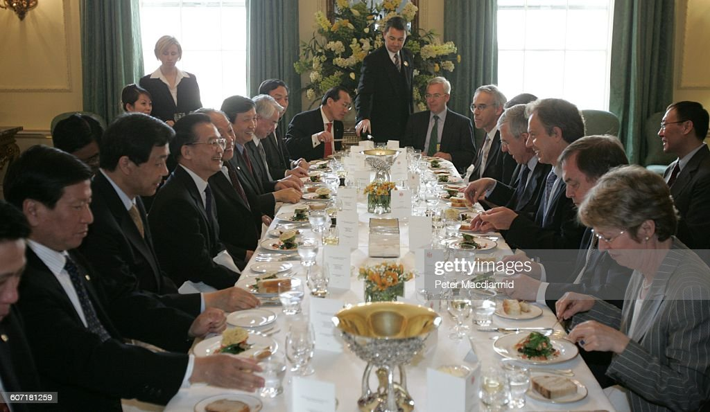 Chinese Premier <a gi-track='captionPersonalityLinkClicked' href=/galleries/search?phrase=Wen+Jiabao&family=editorial&specificpeople=204598 ng-click='$event.stopPropagation()'>Wen Jiabao</a> (fourth left, in eyeglasses) and British Prime Minister <a gi-track='captionPersonalityLinkClicked' href=/galleries/search?phrase=Tony+Blair&family=editorial&specificpeople=118622 ng-click='$event.stopPropagation()'>Tony Blair</a> (third right) share a laugh over a meal at 10 Downing Street, London, England, May 10, 2004.