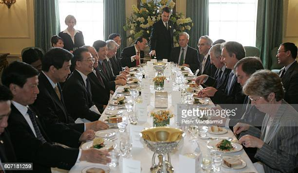 Chinese Premier Wen Jiabao and British Prime Minister Tony Blair share a laugh over a meal at 10 Downing Street London England May 10 2004