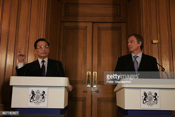 Chinese Premier Wen Jiabao and British Prime Minister Tony Blair speak during a press conference at 10 Downing Street London England May 10 2004