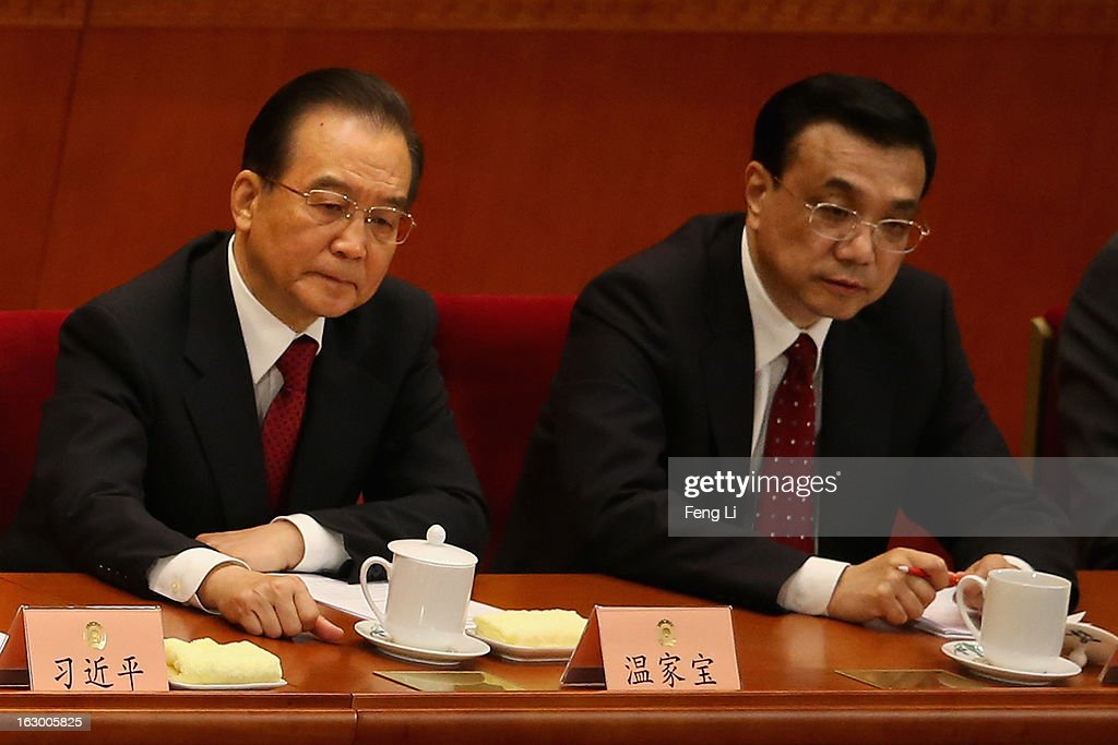 Chinese Premier Wen Jiabao (L) and Chinese Vice Premier Li Keqiang (R) attend the opening session of the Chinese People's Political Consultative Conference in Beijing's Great Hall of the People on March 3, 2013 in Beijing, China. Over 2,000 members of the 12th National Committee of the Chinese People's Political Consultative, a political advisory body, are attending the annual session, during which they will discuss the development of China.