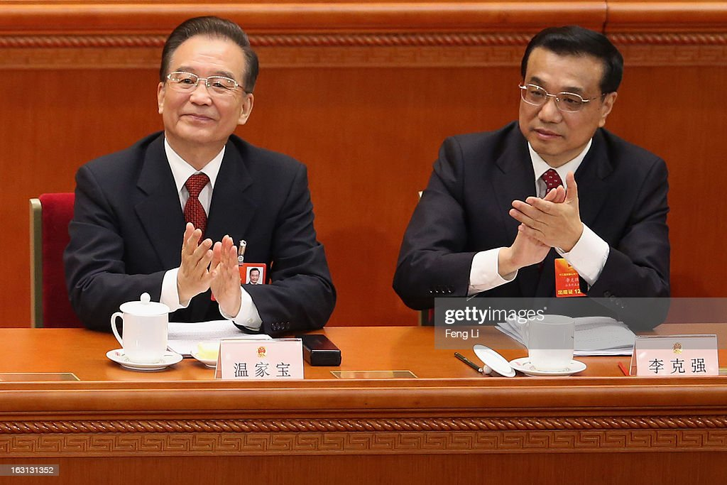 Chinese Premier Wen Jiabao (L) and Chinese Vice Premier Li Keqiang (Right) attend the opening session of the annual National People's Congress in Beijing's Great Hall of the People on March 5, 2013 in Beijing, China. Chinese Premier Wen Jiabao stressed Tuesday that the government should adopt effective measures to prevent and control pollution in response to people's expectations of having a good living environment.
