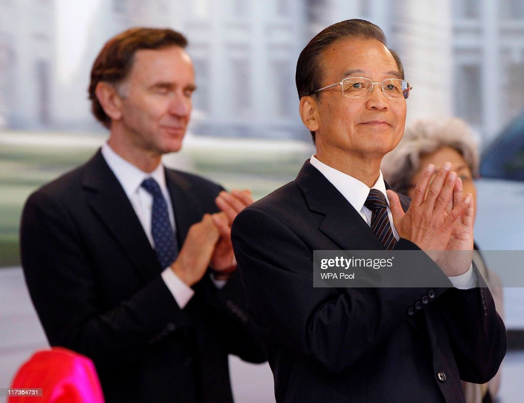 Chinese Premier <a gi-track='captionPersonalityLinkClicked' href=/galleries/search?phrase=Wen+Jiabao&family=editorial&specificpeople=204598 ng-click='$event.stopPropagation()'>Wen Jiabao</a> (R) applauds as an MG6 car is presented during a visit to the MG motor plant on June 26, 2011 in Birmingham, United Kingdom.