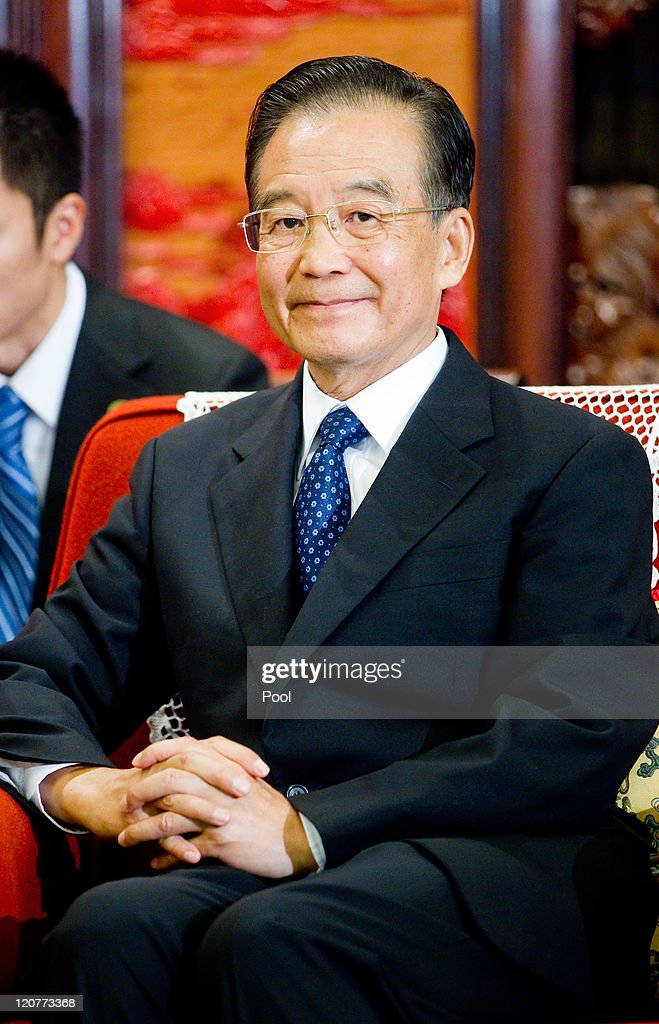 Chinese Premier <a gi-track='captionPersonalityLinkClicked' href=/galleries/search?phrase=Wen+Jiabao&family=editorial&specificpeople=204598 ng-click='$event.stopPropagation()'>Wen Jiabao</a> attends a meeting with President of Mozambique Armando at the Great Hall of the People on August 10, 2011 in Beijing, China. Guebuza is in China for a 6-day official visit at the invitation of Hu Jintao.