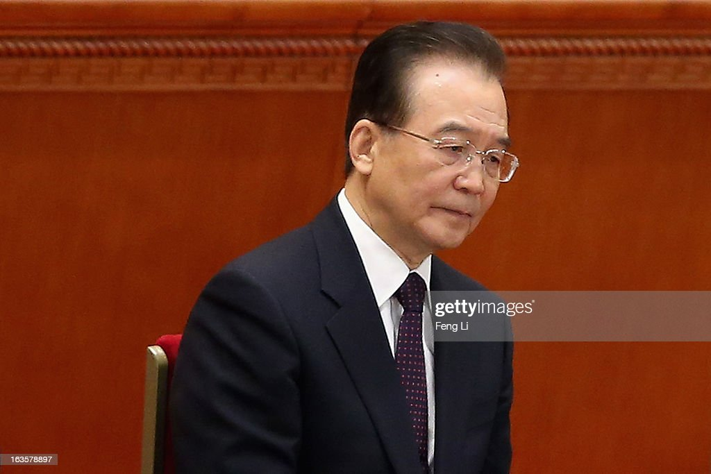 Chinese Premier <a gi-track='captionPersonalityLinkClicked' href=/galleries/search?phrase=Wen+Jiabao&family=editorial&specificpeople=204598 ng-click='$event.stopPropagation()'>Wen Jiabao</a> attends the closing session of the annual Chinese People's Political Consultative Conference (CPPCC) held at the Great Hall of the People on March 12, 2013 in Beijing, China. The newly-elected Chairman of the CPPCC Yu Zhengsheng pledged Tuesday that China will not copy Western political systems under any circumstances.