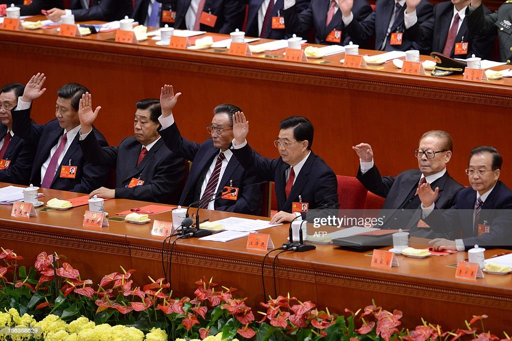 Chinese premier Wen Jiabao (R),Chinese former president Jiang Zemin (2R), Chinese president Hu Jintao (3R) and Chinese vice president Xi Jinping (L) vote during the closing of the 18th Communist Party Congress at the Great Hall of the People in Beijing on 14 November 2012. The week-long Communist Party Congress will end with a transition of power to Chinese Vice President Xi Jinping, who will govern for the coming decade amid growing pressure for reform of the communist regime's iron-clad grip on power. AFP PHOTO/WANG ZHAO