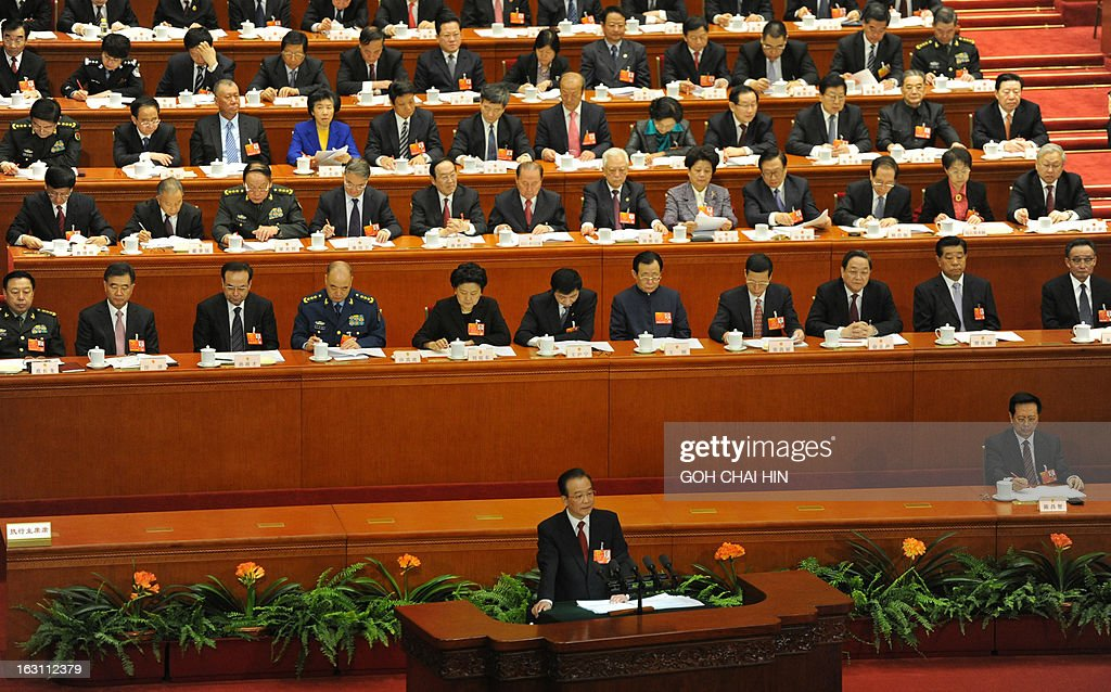 Chinese Premier Wen Jiabao (lower) delivers his final report at the opening session of the Chinese National People's Congress (NPC) at the Great Hall of the People in Beijing on March 5, 2013. China set its economic growth target for this year at 7.5 percent, unchanged on 2012, ahead of the opening on March 5 of the annual parliament session of the world's second-largest economy.