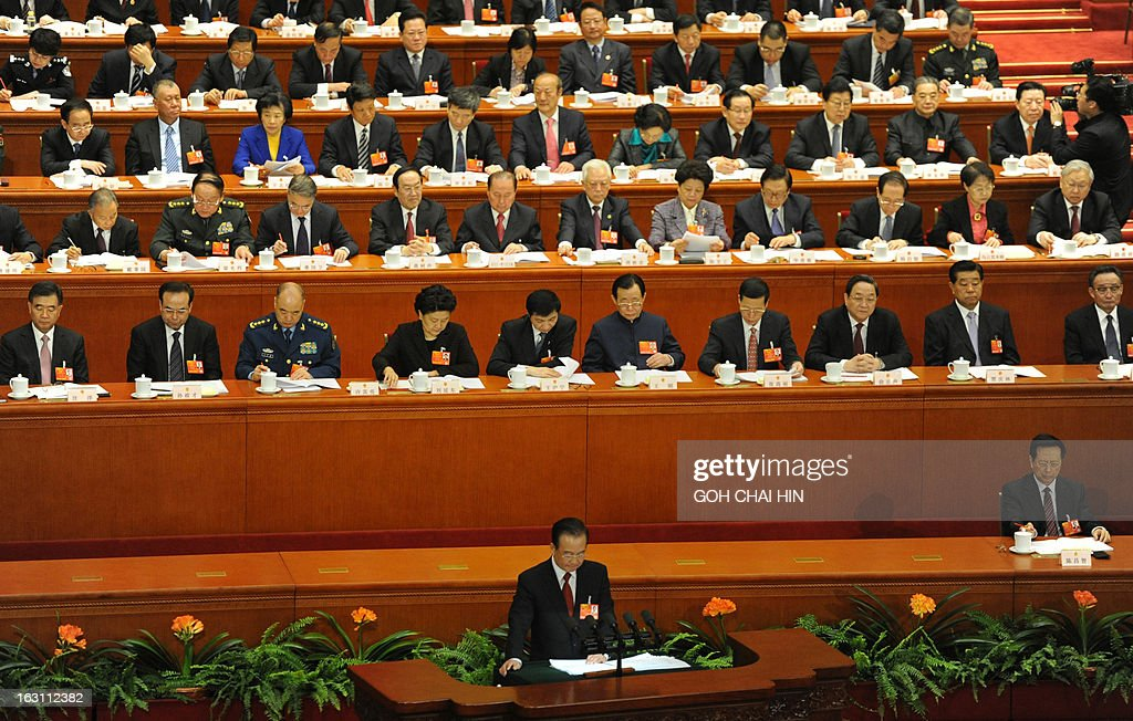 Chinese Premier Wen Jiabao (lower) delivers his final report at the opening session of the Chinese National People's Congress (NPC) at the Great Hall of the People in Beijing on March 5, 2013. China set its economic growth target for this year at 7.5 percent, unchanged on 2012, ahead of the opening on March 5 of the annual parliament session of the world's second-largest economy. AFP PHOTO /GOH CHAI HIN