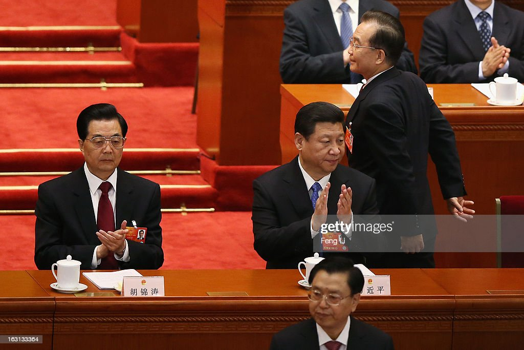 Chinese Premier Wen Jiabao go to deliver the work report as Communist Party chief Xi Jinping (C) and Chinese President Hu Jintao (L) applauding during the opening session of the annual National People's Congress in Beijing's Great Hall of the People on March 5, 2013 in Beijing, China. Chinese Premier Wen Jiabao stressed Tuesday that the government should adopt effective measures to prevent and control pollution in response to people's expectations of having a good living environment.
