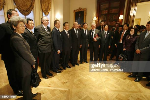 Chinese Premier Wen Jiabao has a group photograph taken as he attends a meeting with young business people at the Mandarin Oriental Hotel in...