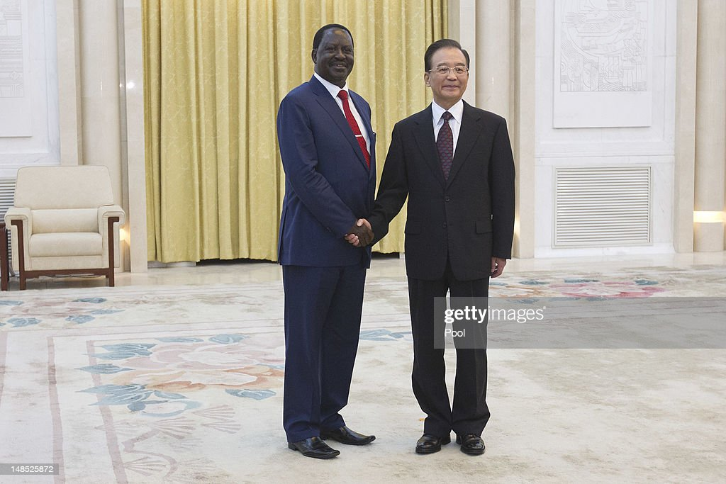 Chinese Premier <a gi-track='captionPersonalityLinkClicked' href=/galleries/search?phrase=Wen+Jiabao&family=editorial&specificpeople=204598 ng-click='$event.stopPropagation()'>Wen Jiabao</a> (R) shakes hands with Kenyan Prime Minister <a gi-track='captionPersonalityLinkClicked' href=/galleries/search?phrase=Raila+Odinga&family=editorial&specificpeople=2147626 ng-click='$event.stopPropagation()'>Raila Odinga</a> during their meeting at the Great Hall of the People July 18, 2012 in Beijing, China,