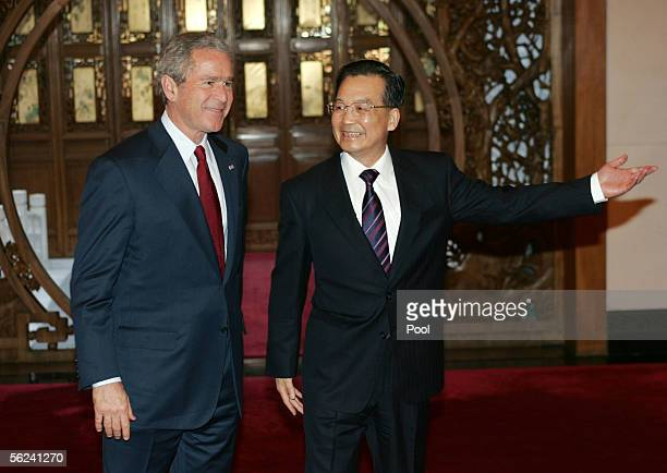 Chinese Premier Wen Jiabao shows the way for US President George W Bush at the Diaoyutai State Guest House November 20 2005 in Beijing China Bush is...