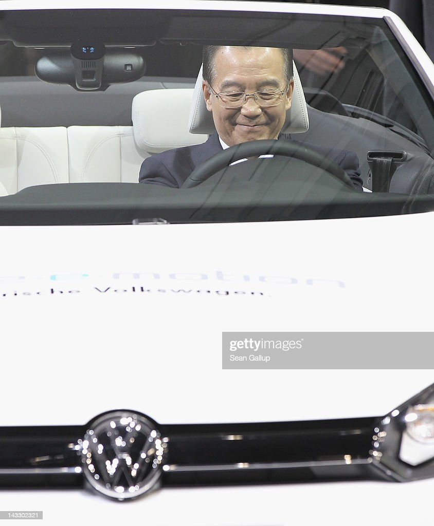 Chinese Premier Wen Jiabao sits behind the steering wheel of a Volkswagen EOS electric car at the Volkswagen factory on April 23, 2012 in Wolfsburg, Germany. Winterkorn and representatives of Chinese companies signed an agreement minutes before to extend Volkswagen's production in China and also allow the construction of another plant.