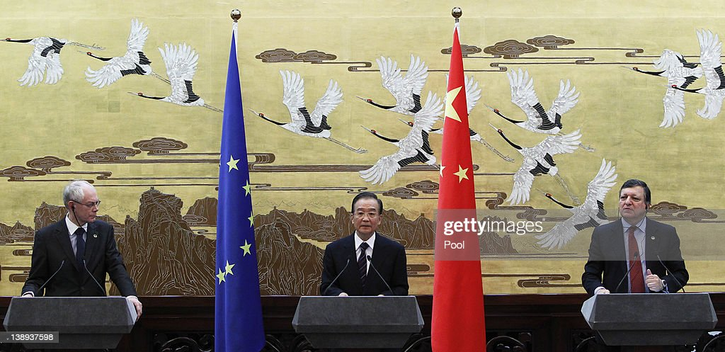 Chinese Premier Wen Jiabao speaks to reporters as European Commission President Jose Manuel Barroso and European Council President Herman Van Rompuy...