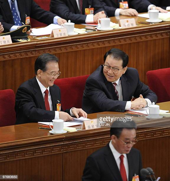 Chinese Premier Wen Jiabao talks to member of Chinese politburo Li Changchun during the closing session of the National People's Congress at the...