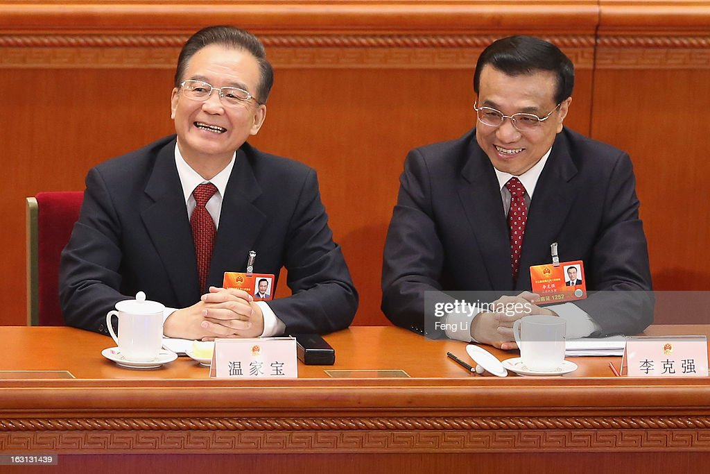 Chinese Premier Wen Jiabao (L) talks with Chinese Vice Premier Li Keqiang (Right) after Wen delivered his work report at the opening session of the annual National People's Congress in Beijing's Great Hall of the People on March 5, 2013 in Beijing, China. Chinese Premier Wen Jiabao stressed Tuesday that the government should adopt effective measures to prevent and control pollution in response to people's expectations of having a good living environment.