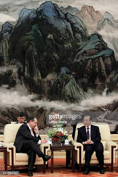Chinese Premier Wen Jiabao talks with Dow Chemical Company Chairman President and CEO Andrew Liveris during a meeting with entrepreneurs from various...