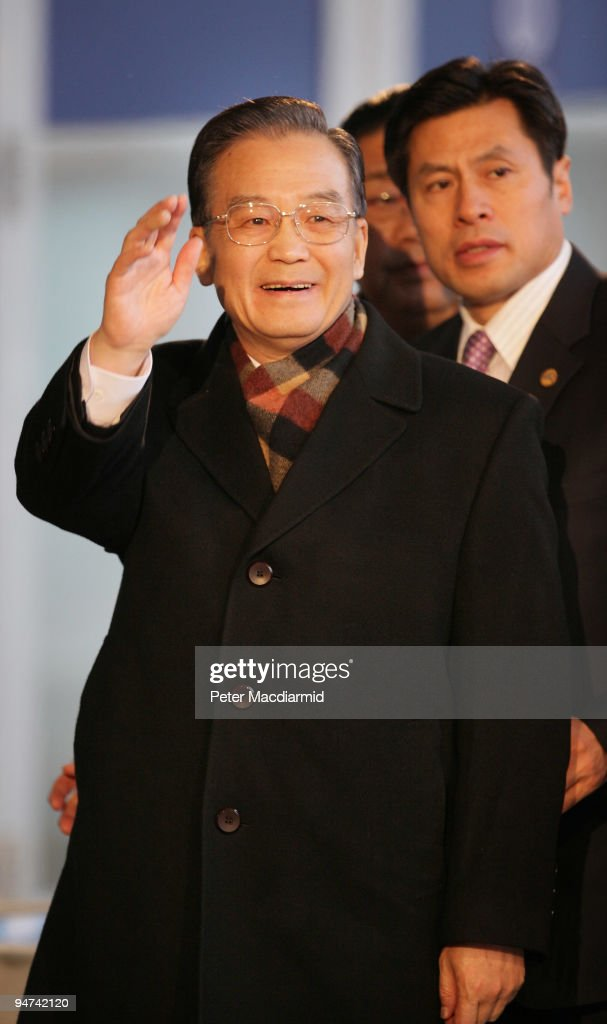 Chinese Premier Wen Jiabao waves to reporters as he arrives for the final day of the UN Climate Change Conference on December 18, 2009 in Copenhagen, Denmark. World leaders will try to reach agreement on targets for reducing the earth's carbon emissions on this last day of the summit.