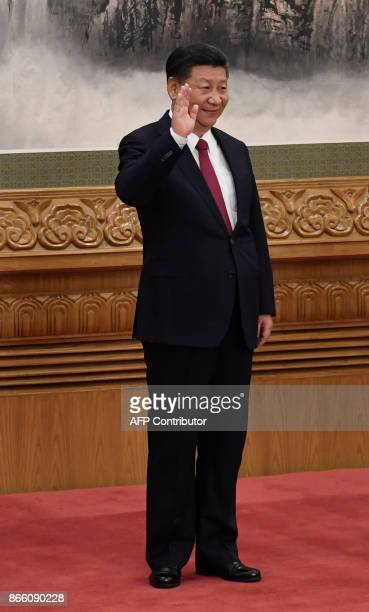 Chinese President and General Secretary of the Communist Party Xi Jinping stands during the introduction of the Communist Party of China's Politburo...