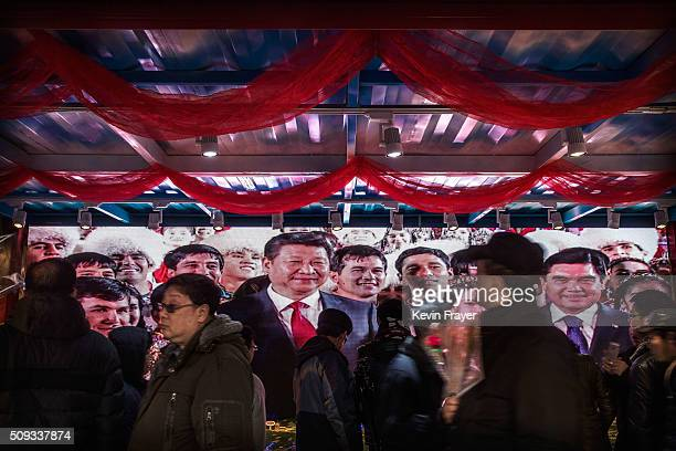 Chinese president and leader of the Communist Party Xi Jinping is seen on a television monitor at a government promotional booth at a local fair...
