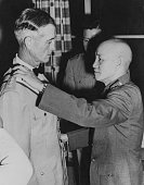 Chinese President Chiang G KaiShek talking to General Earle E Partridge US Far East Commander at the Presidential Mansion in Taipei June 4th 1955