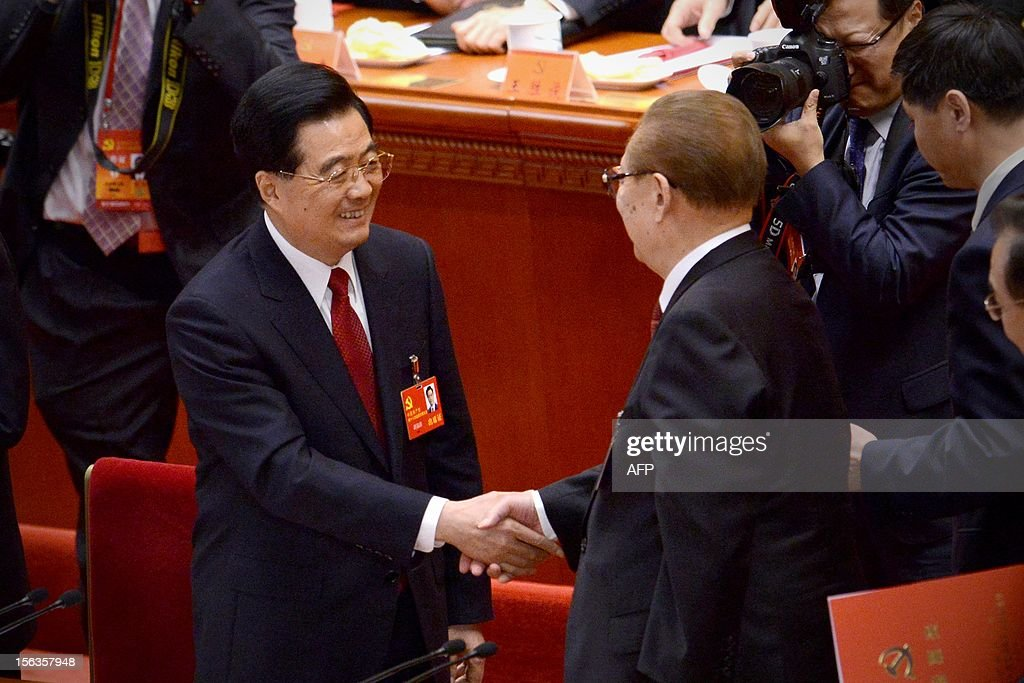 Chinese President Hu Jinta o(L) shakes hands with former president Jiang Zemin (R) after the closing of the 18th Communist Party Congress at the Great Hall of the People in Beijing on 14 November 2012. The week-long Communist Party Congress will end with a transition of power to Chinese Vice President Xi Jinping, who will govern for the coming decade amid growing pressure for reform of the communist regime's iron-clad grip on power. AFP PHOTO/WANG ZHAO