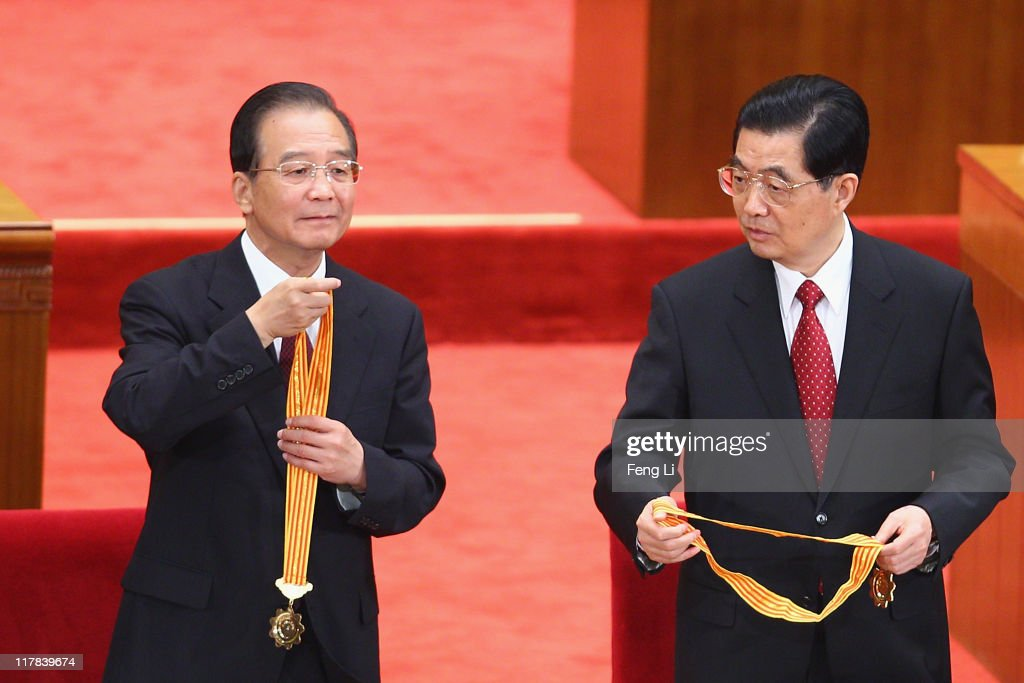 Chinese President Hu Jintao (Right) and Chinese Premier Wen Jiabao (Left) award medals for the outstanding Communists during the celebration of the Communist Party's 90th anniversary at the Great Hall of the People on July 1, 2011 in Beijing, China.