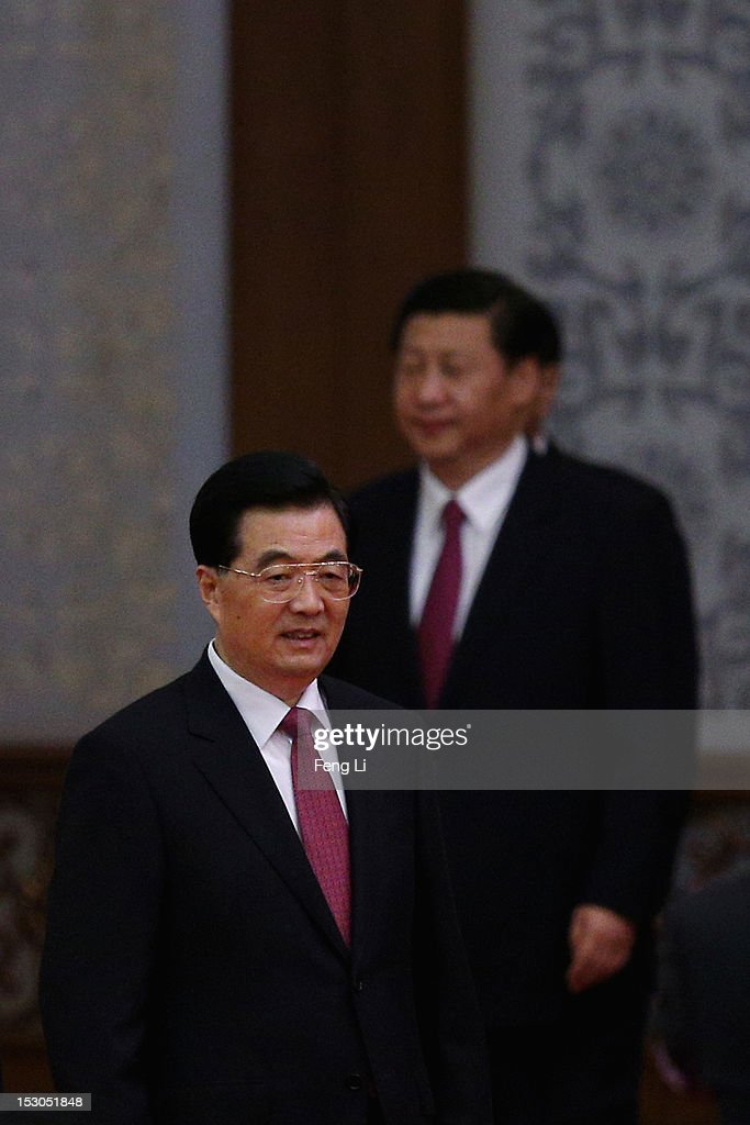 Chinese President Hu Jintao and Chinese Vice President Xi Jinping attend the banquet marking the 63th anniversary of the founding of the People's...