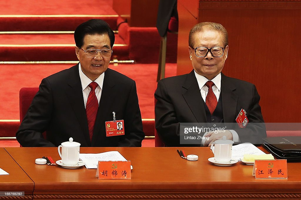 Chinese President Hu Jintao and Former Chinese President Jiang Zemin attend the opening session of the 18th Communist Party Congress held at the...
