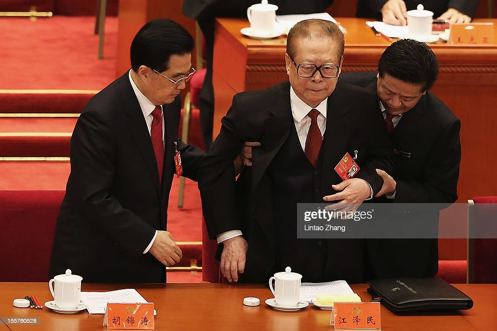 Chinese President Hu Jintao and former Chinese President Jiang Zemin attend the opening session of the18th Communist Party Congress held at the Great...