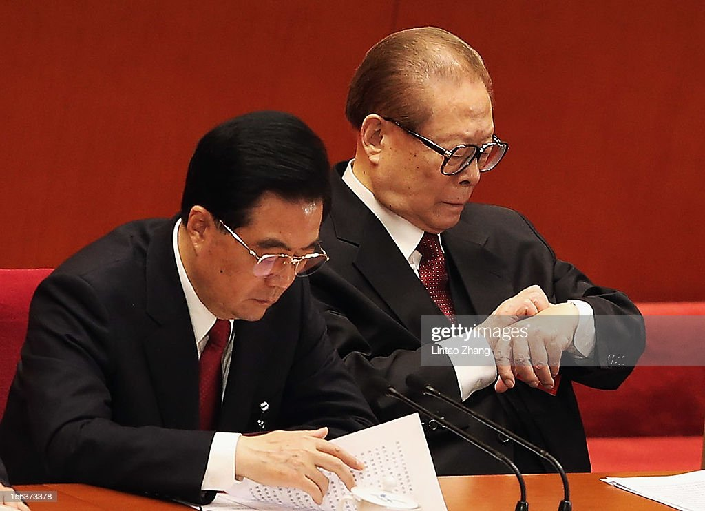 Chinese President Hu Jintao and former president Jiang Zemin attend closing of the 18th Communist Party Congress at the Great Hall of the People on...