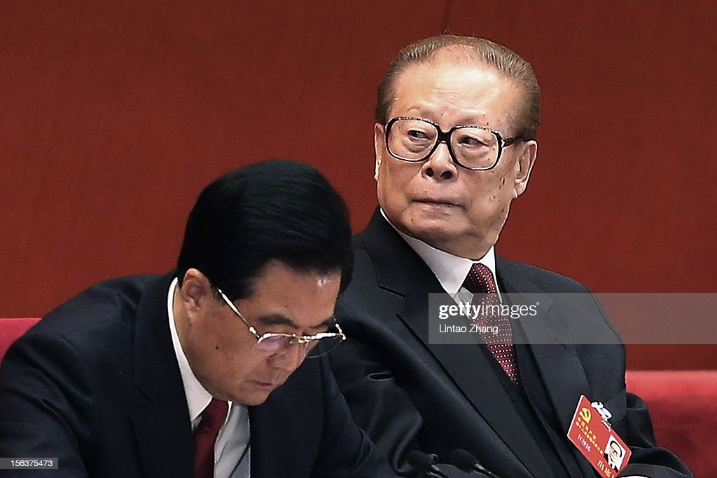Chinese President Hu Jintao (L) and former president Jiang Zemin attend closing of the 18th Communist Party Congress at the Great Hall of the People on November 14, 2012 in Beijing, China. The Communist Party Congress will convene from November 8-14 and will determine the party's next leaders.