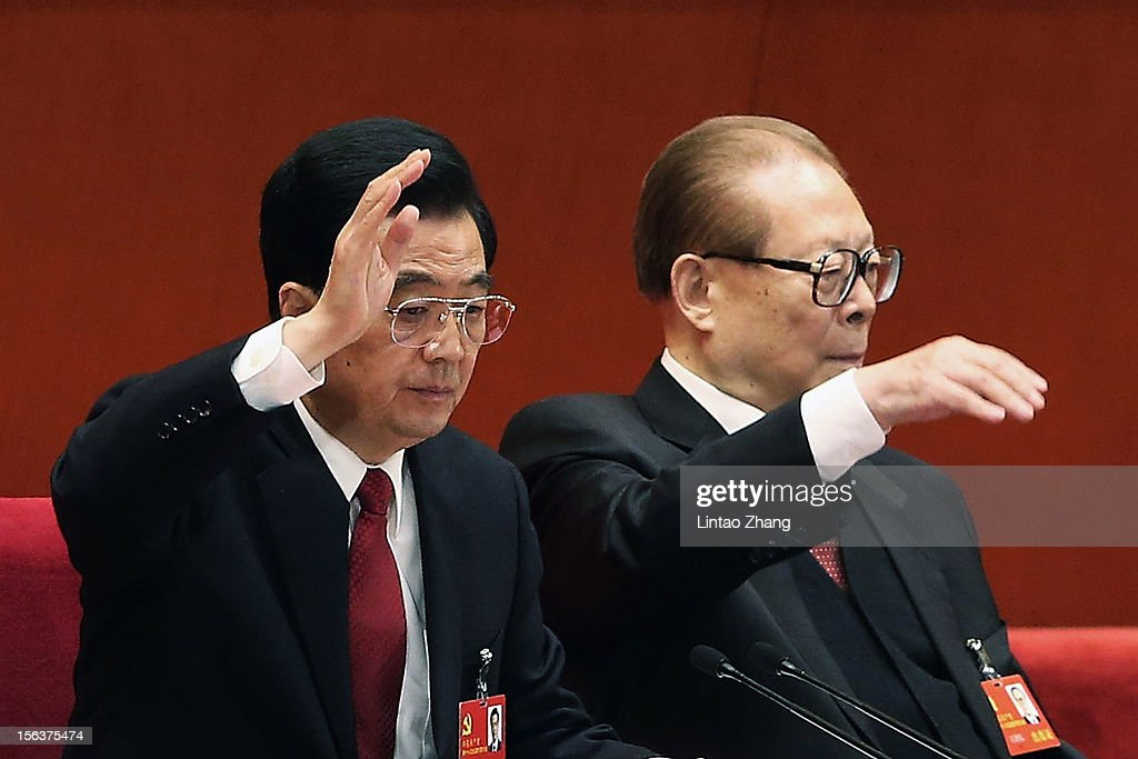 Chinese President Hu Jintao (L) and former president Jiang Zemin vote at the closing of the 18th Communist Party Congress at the Great Hall of the People on November 14, 2012 in Beijing, China. The Communist Party Congress will convene from November 8-14 and will determine the party's next leaders.