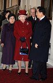 Chinese President Hu Jintao and his wife Liu Yongqing accompanied by Queen Elizabeth ll and Prince Philip Duke of Edinburgh arrive at the grand...