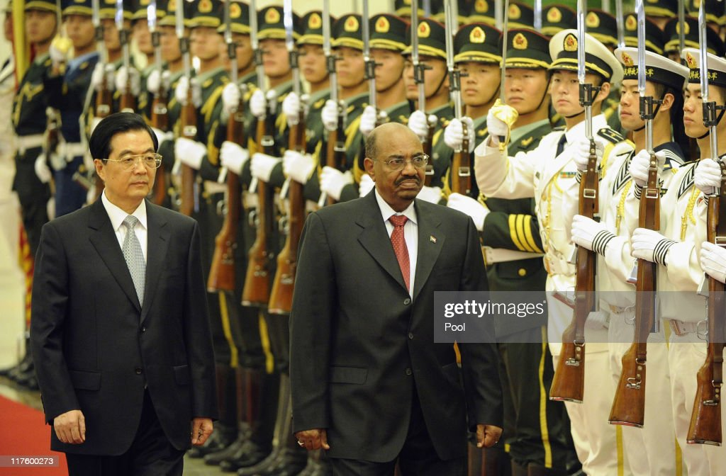 Chinese President Hu Jintao and President of Sudan Omar al-Bashir review the Chinese military honour guard during a welcoming ceremony at the Great Hall of the People on June 29, 2011 in Beijing, China. Omar al-Bashir, who is wanted by the International Criminal Court for alleged war crimes, is on a four-day visit to China.
