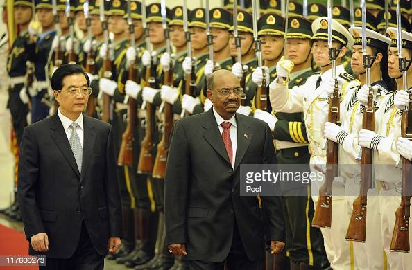 Chinese President Hu Jintao and President of Sudan Omar alBashir review the Chinese military honour guard during a welcoming ceremony at the Great...