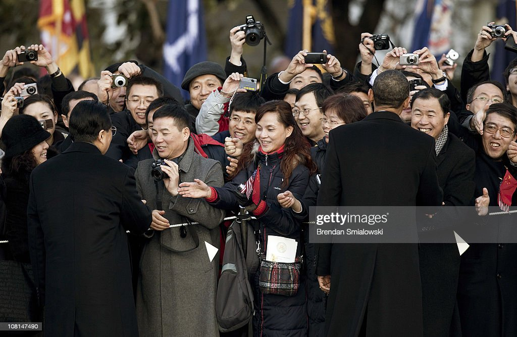 Chinese President <a gi-track='captionPersonalityLinkClicked' href=/galleries/search?phrase=Hu+Jintao&family=editorial&specificpeople=203109 ng-click='$event.stopPropagation()'>Hu Jintao</a> (L) and U.S. President <a gi-track='captionPersonalityLinkClicked' href=/galleries/search?phrase=Barack+Obama&family=editorial&specificpeople=203260 ng-click='$event.stopPropagation()'>Barack Obama</a> greet guests during a state arrival ceremony on the South Lawn of the White House January 19, 2011 in Washington, DC. Obama and Hu are schedule to meet in the Oval Office later in the day, hold a joint press conference and attend a State dinner.