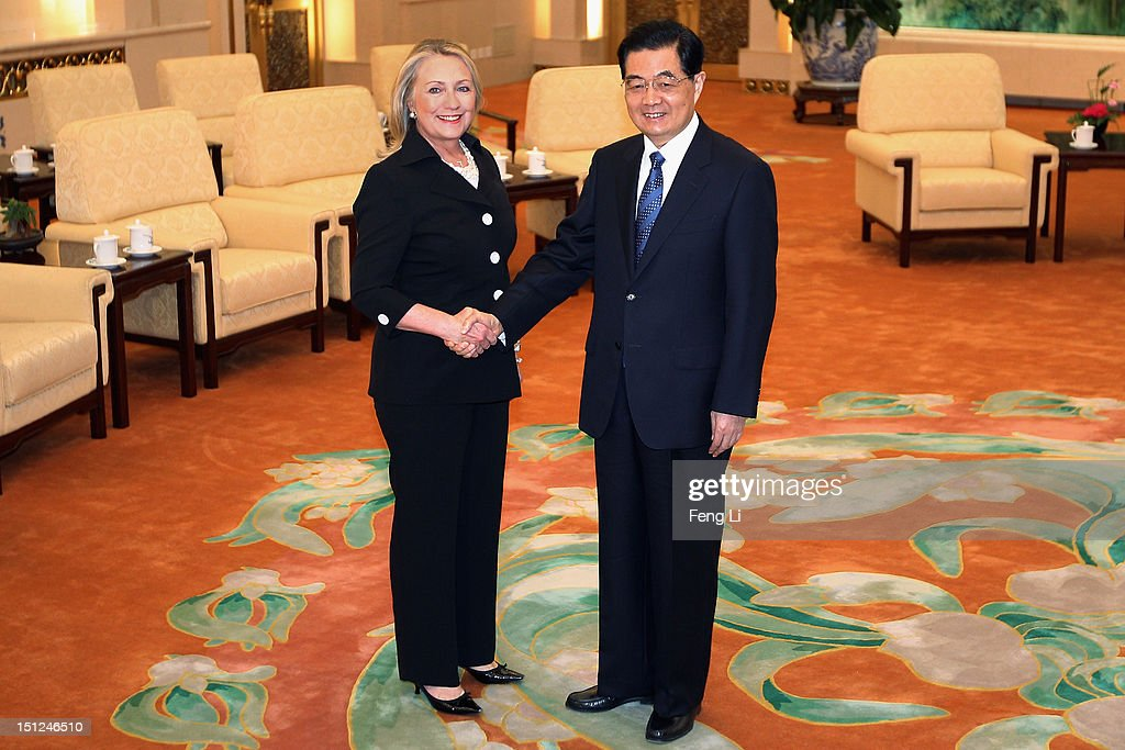 Chinese President Hu Jintao (R) and US Secretary of State Hillary Clinton (L) shake hands at the Great Hall of the People in Beijing on September 5, 2012.