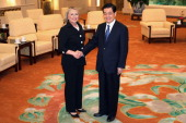 Chinese President Hu Jintao and US Secretary of State Hillary Clinton shake hands at the Great Hall of the People in Beijing on September 5 2012