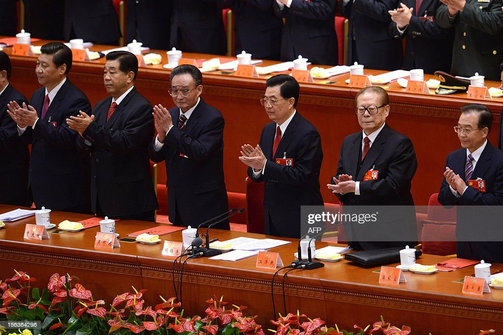 Chinese President Hu Jintao (3rd-right) applauds with other Chinese leaders during the closing of the 18th Communist Party Congress at the Great Hall of the People in Beijing on 14 November, 2012. The week-long Communist Party Congress will end with a transition of power to Chinese Vice President Xi Jinping, who will govern for the coming decade amid growing pressure for reform of the communist regime's iron-clad grip on power.