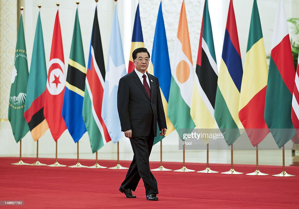 Chinese president Hu Jintao arrives for a group photo session for the 5th Ministerial Conference of the Forum on ChinaAfrica Cooperation held at the...