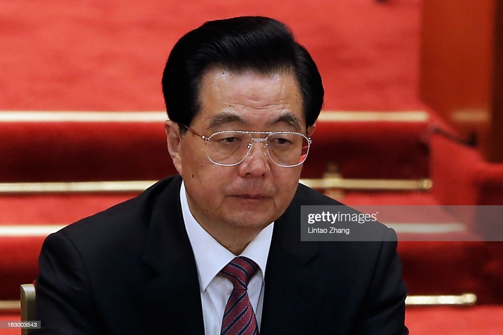 Chinese President <a gi-track='captionPersonalityLinkClicked' href=/galleries/search?phrase=Hu+Jintao&family=editorial&specificpeople=203109 ng-click='$event.stopPropagation()'>Hu Jintao</a> attend the opening session of the Chinese People's Political Consultative Conference at Great Hall of the People on March 3, 2013 in Beijing, China. Over 2000 members of the 12th National Committee of the Chinese People's Political Consultative, a political advisory body, are attending the annual session, during which they will discuss the development of China.
